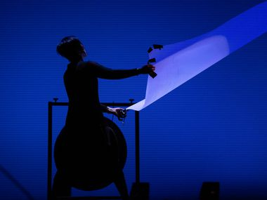 Min Xiao-Fen rustles a long paper swath during the Chamber Music International performance of Tan Dun's Ghost Opera at the Charles W. Eisemann Center for Performing Arts in Richardson Sept. 27, 2019.