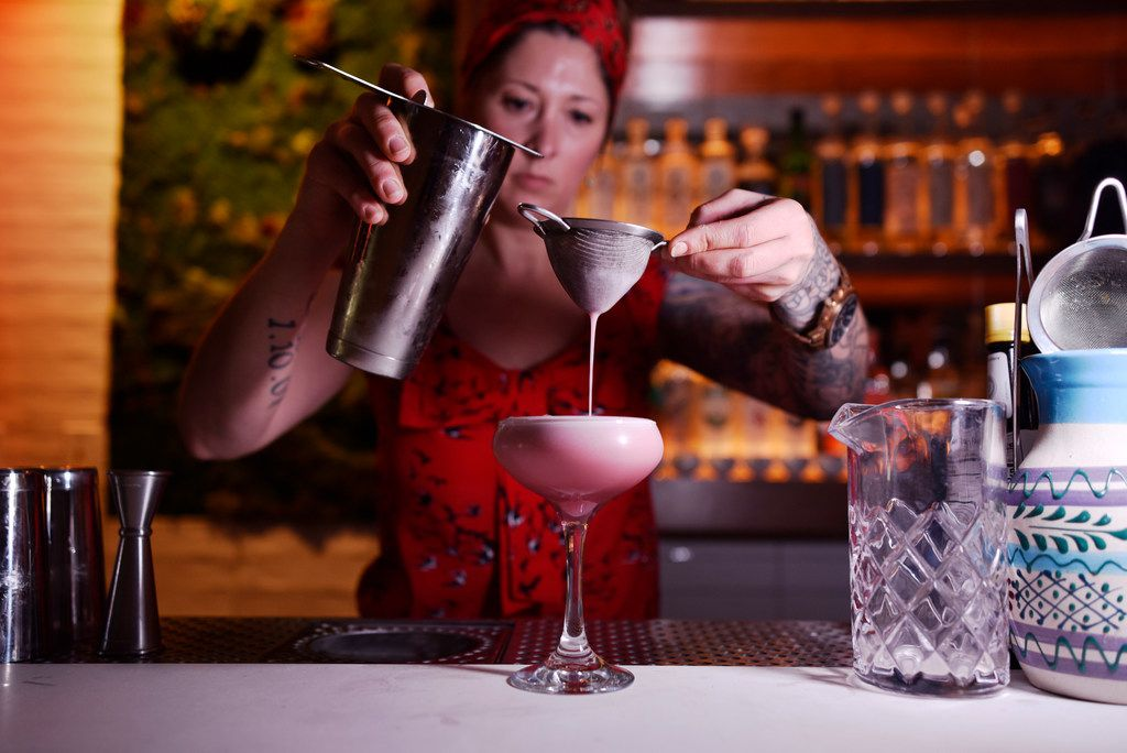 La Viuda Negra bar manager Candice Ruibal prepares a Pancho Ancho cocktail at the new speakeasy-style bar La Viuda Negra in Dallas. The drink is made with El Silencio Espadin mezcal, pomegranate juice, pineapple, arbol and ancho chiles, rose water and egg white.