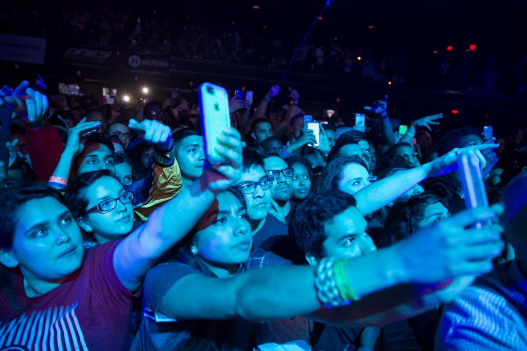 Fans stretch to take cell phone photos of J Cole at the ACL Moody Theater in Austin, Texas on March 21, 2015.(Julia Robinson/Special Contributor)