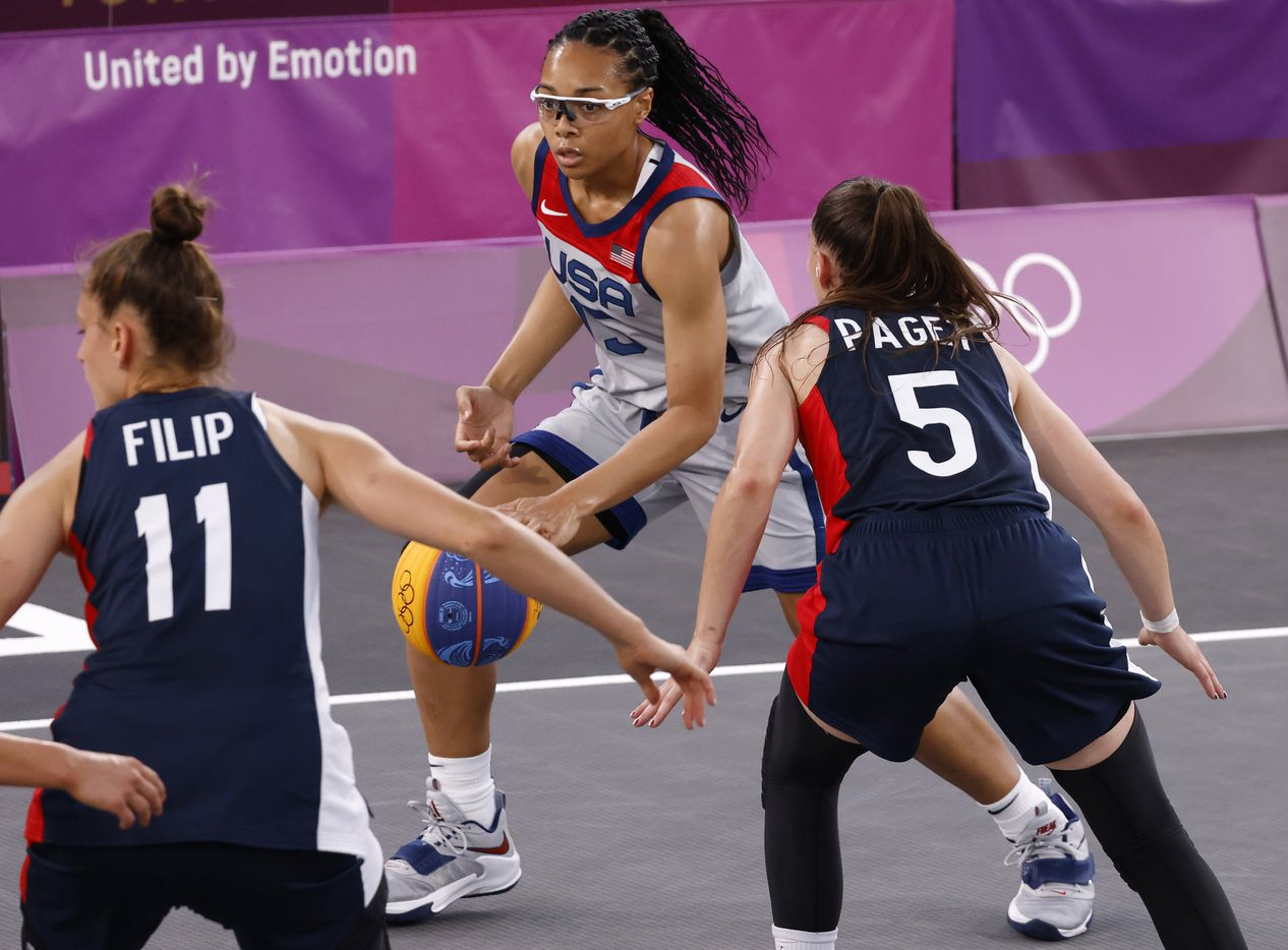 USA's Allisha Gray (15) dribbles as France's Marie-Eve Paget (5) defends during a 3x3 women's basketball game during the postponed 2020 Tokyo Olympics at Aomi Urban Sports Park on Saturday, July 24, 2021, in Tokyo, Japan. USA defeated France 17-10 in the game. (Vernon Bryant/The Dallas Morning News)