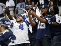 Dallas Cowboys fans celebrate after Dallas Cowboys kicker Greg Zuerlein (2) kicks the winning field goal in the final seconds to win against the Atlanta Falcons in the home opener of the second half of play at AT&T Stadium in Arlington, Texas on Sunday, September 20, 2020. Dallas Cowboys defeated the Atlanta Falcons 40-39.