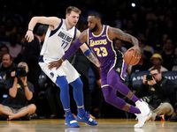 Los Angeles Lakers' LeBron James (23) is defended by Dallas Mavericks' Luka Doncic (77) during the first half of an NBA basketball game Wednesday, Oct. 31, 2018, in Los Angeles. (AP Photo/Marcio Jose Sanchez)