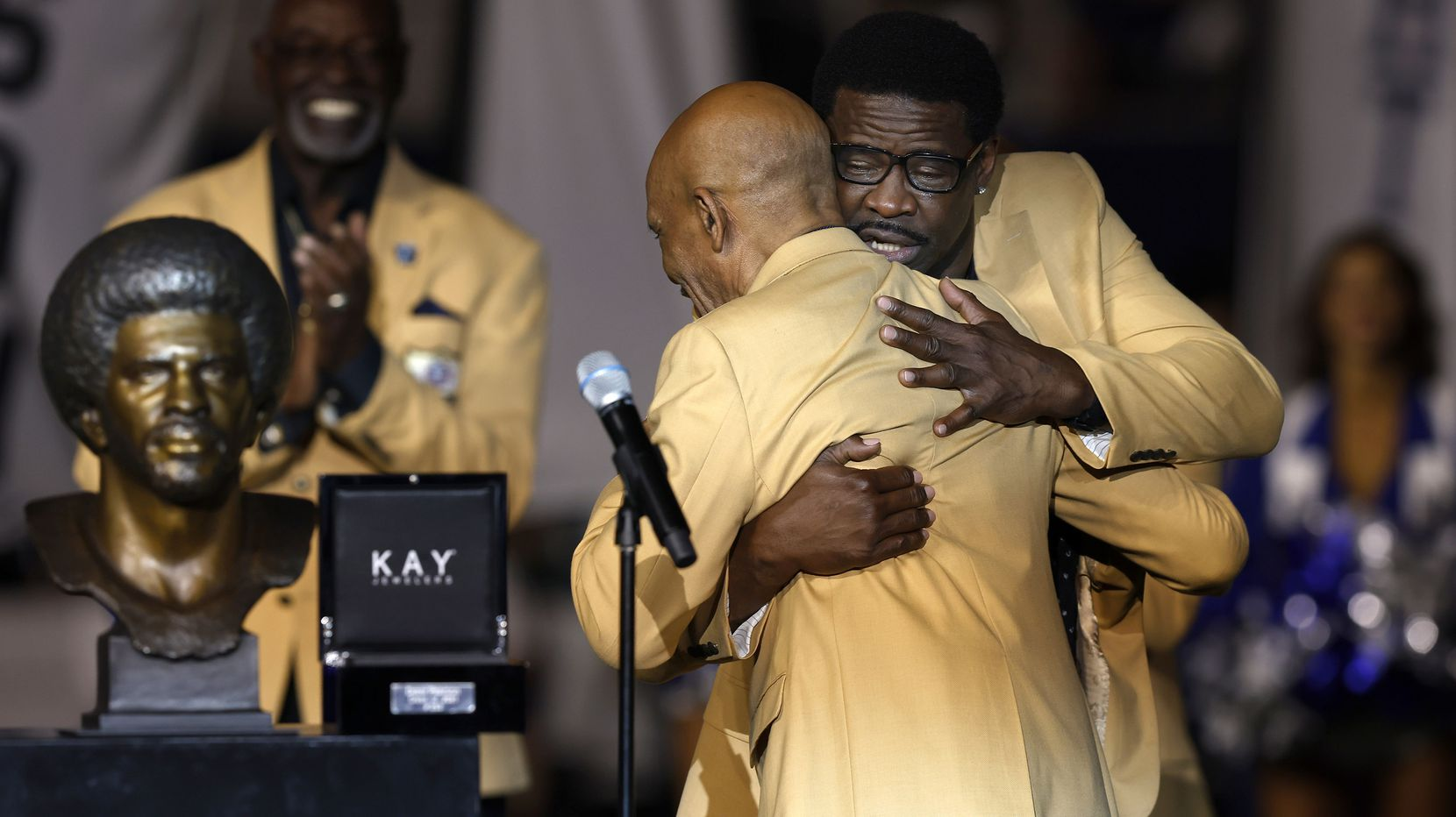 Dallas Cowboys Pro Football Hall of Famer Drew Pearson (left) receives a hug from another Cowboys #88, Hall of Famer Michael Irvin, during a ring ceremony at AT&T Stadium in Arlington, Monday, September 27, 2021. (Tom Fox/The Dallas Morning News)