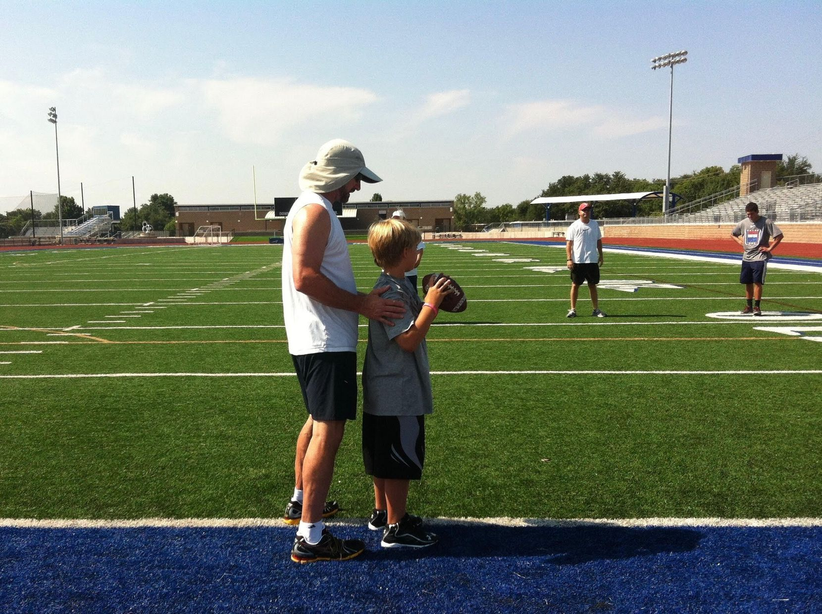 Former NFL quarterback and Dallas Cowboys radio color analyst Babe Laufenberg coaches nine-year-old Brayden Schager. Schager, now a senior, is expected to be the starting quarterback at Highland Park this fall.