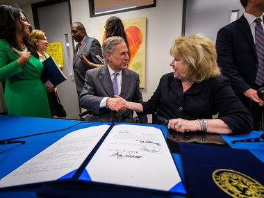 Governor Greg Abbott shakes hands with Sen. Jane Nelson as Rep. Victoria Neave (far left) looks on following a bill signing ceremony at New Friends New Life on Tuesday, June 4, 2019, in Dallas.  The Governor signed legislation related to human trafficking and the elimination of the rape kit backlog. This week, Abbott made it easier for incarcerated victims of human trafficking to seek clemency.