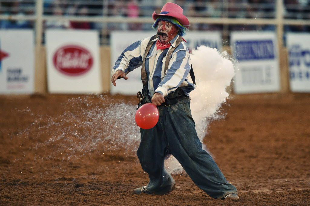A pyrotechnic goes off on the backside of Rodeo clown Rudy Burns during a skit at the Miller Lite Bull Blowout rodeo event at the North Texas Fair and Rodeo, Thursday, August 27, 2015, in Denton, TX. David Minton/DRC