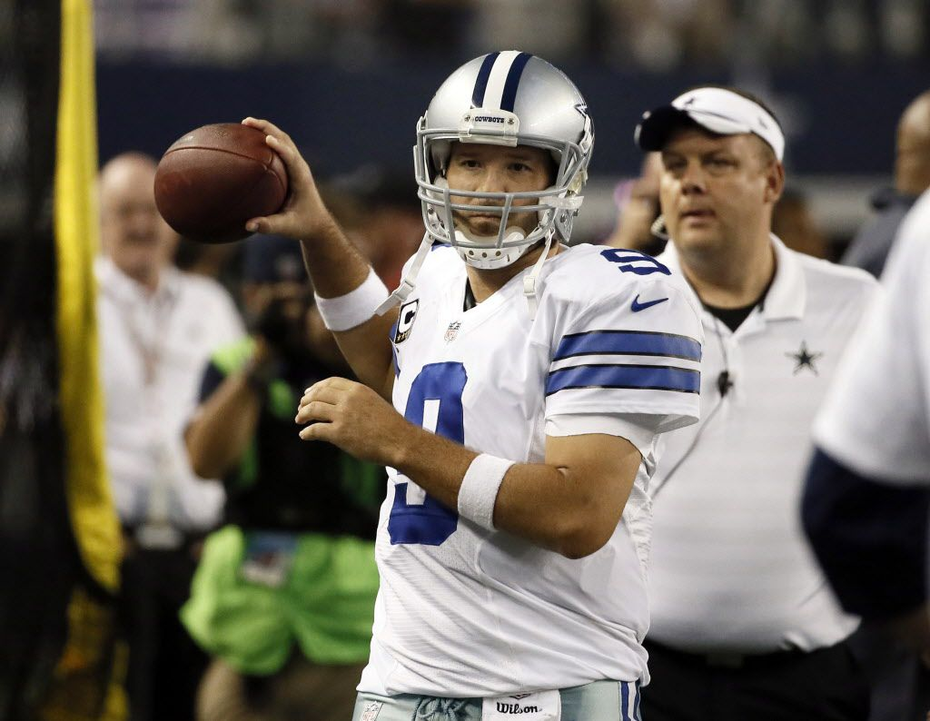 Dallas Cowboys quarterback Tony Romo throws on the sideline after being helped off the field following a hit by Washington Redskins inside linebacker Keenan Robinson during the second half of an NFL football game, Monday, Oct. 27, 2014, in Arlington, Texas. (AP Photo/Brandon Wade)