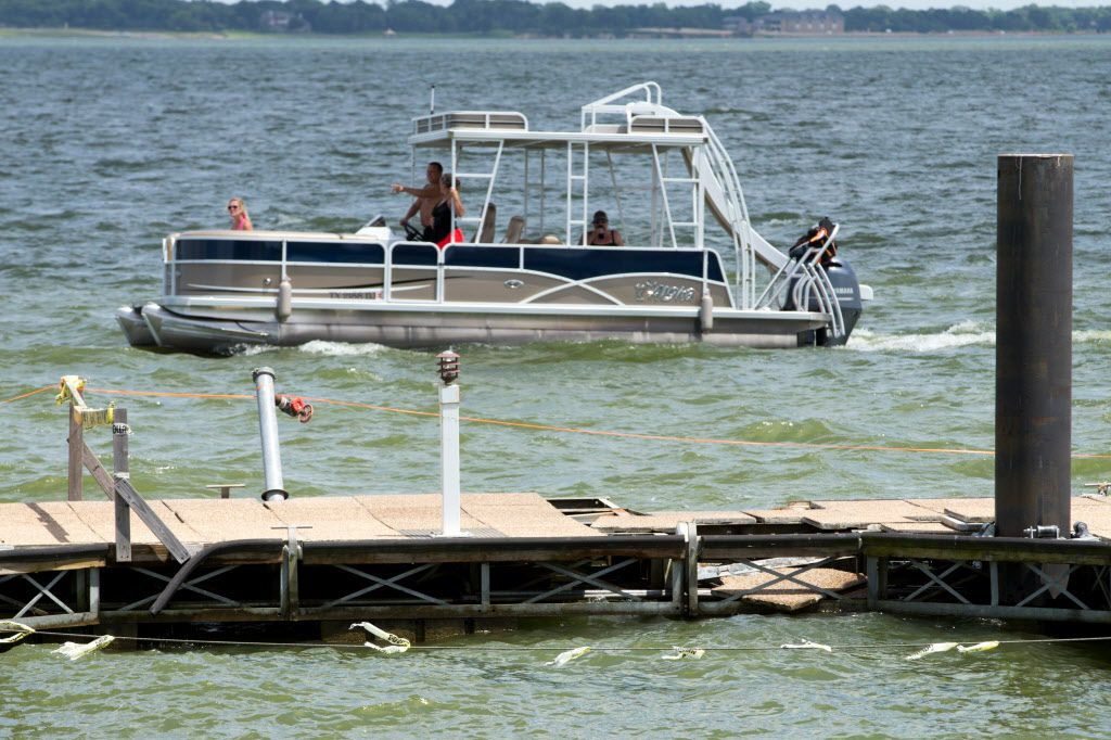 Damages on the closed off Harbor Point boat dock on June 25, 2016 in Garland. (Ting Shen/The Dallas Morning News)