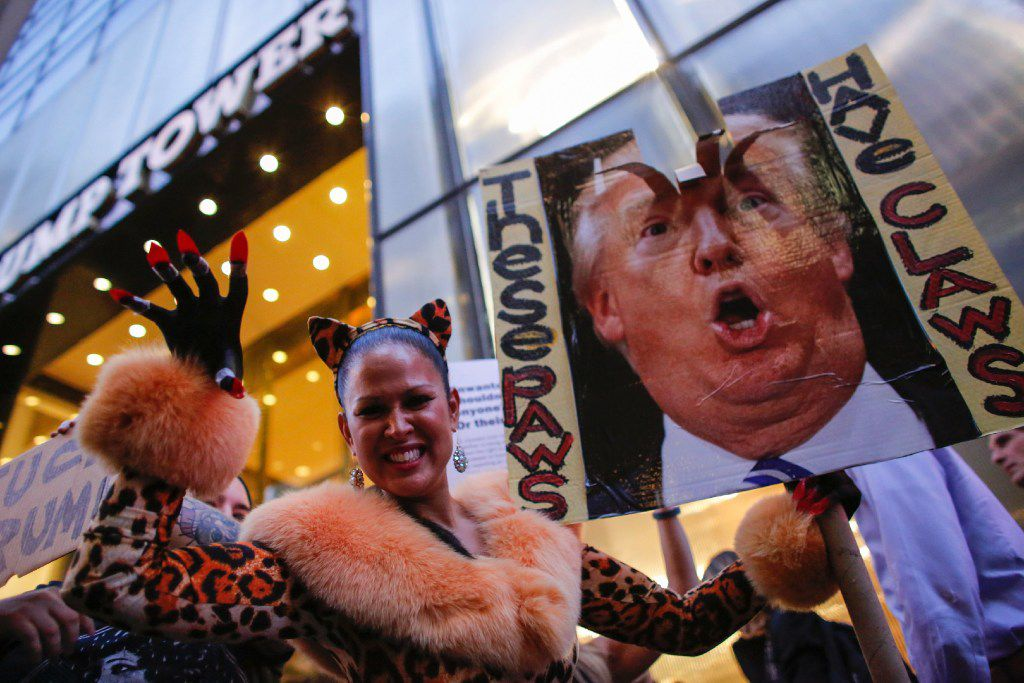 A woman dressed up as a feline takes part of a protest outside Trump Tower in New York to protest against Republican presidential candidate Donald Trump for his treatment of women.