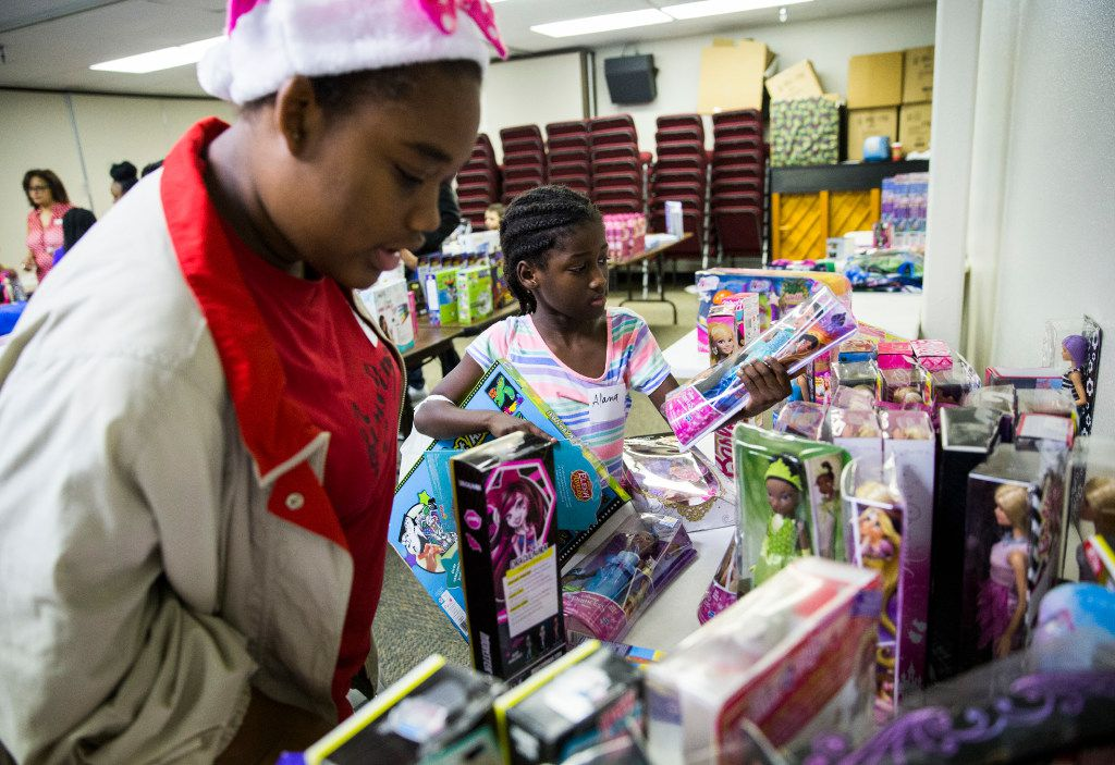 Alexis Sanders, 16, and Alana Graves, 7, look at toys during The Big Christmas Do-Over in Rowlett.