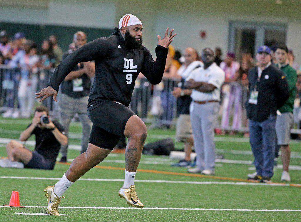 Miami defensive tackle Gerald Willis runs the 40-yard dash at the NCAA college football team's NFL Pro Day in Miami, Monday, March, 25, 2019. (Charles Trainor Jr./Miami Herald via AP)