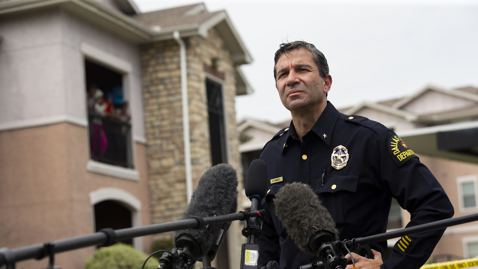 Deputy Chief Reuben Ramirez speaks to the media at the scene of a triple homicide in Dallas on Monday.