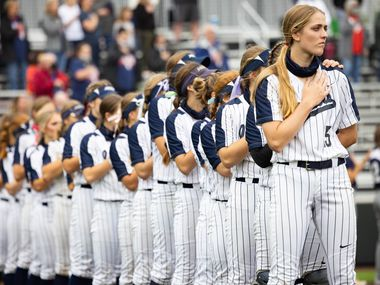 Flower Mound's pitcher Landrie Harris (15) stands with her team during the national anthem before a softball Class 6A bi-district playoff game against McKinney Boyd on Friday, April 30, 2021, in Denton.