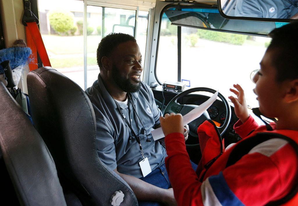 David Velasquez, a fifth-grader at Lake Highlands Elementary School, talked with Curtis Jenkins, a Richardson ISD bus driver, about his report card on April 17, 2019.