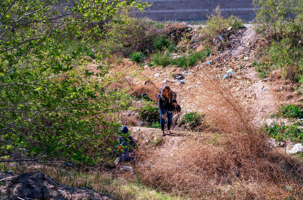 A mother and her son crossed the Rio Grande between El Paso and Ciudad Juarez, Mexico, to claim asylum in the U.S. on March 19.