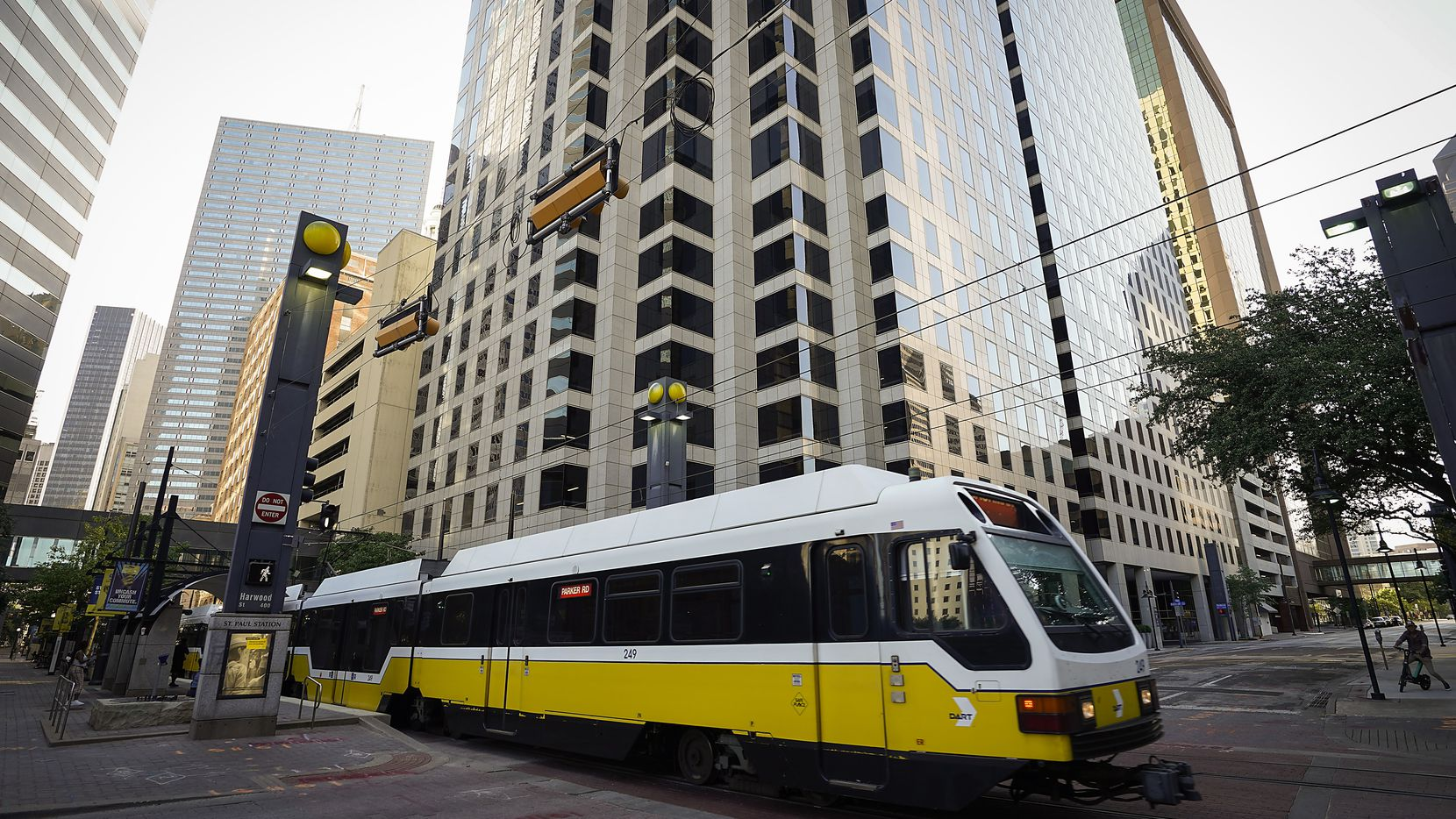 A DART rail train departs St. Paul Station in front of Harwood Center.