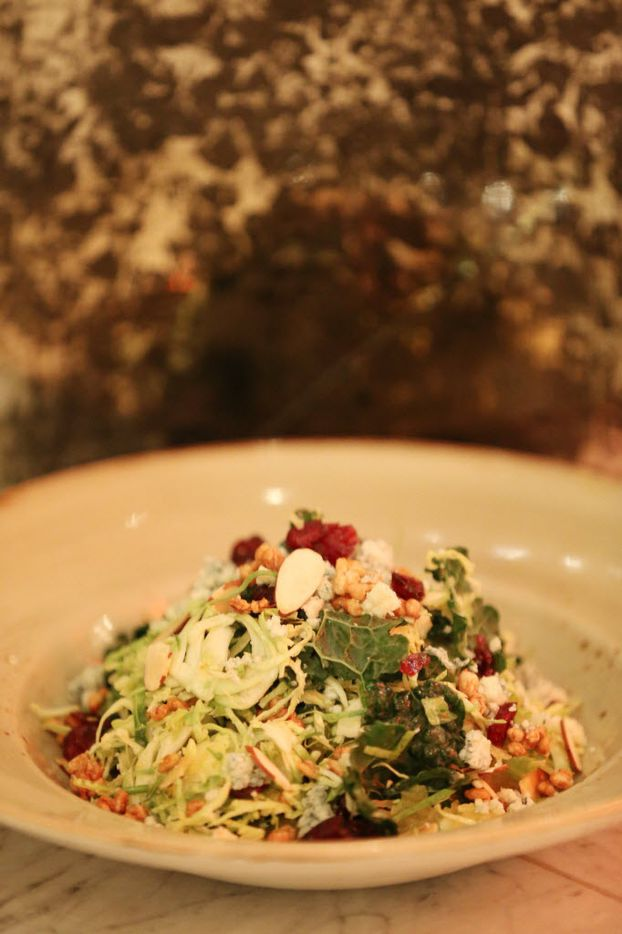 Shaved Brussels sprouts and dried cranberry salad with blue cheese, toasted almonds and roasted spaghetti squash