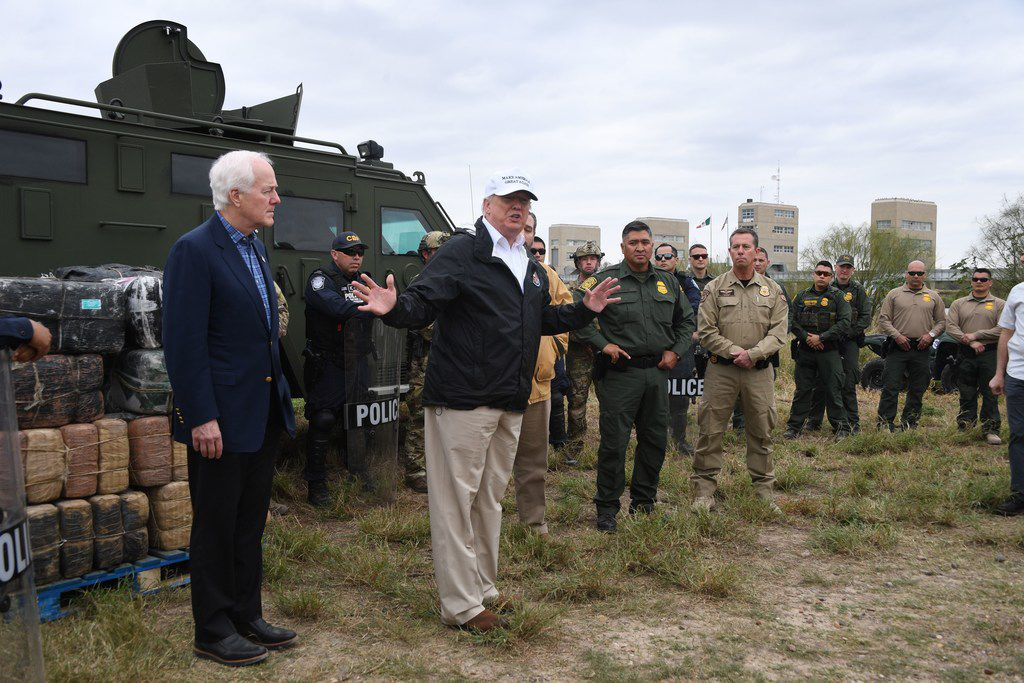 President Donald Trump stands next to Sen. John Cornyn (left) as he speaks to Border Patrol agents near the Rio Grande after his visit to the U.S. Border Patrol station in McAllen on January 10, 2019.