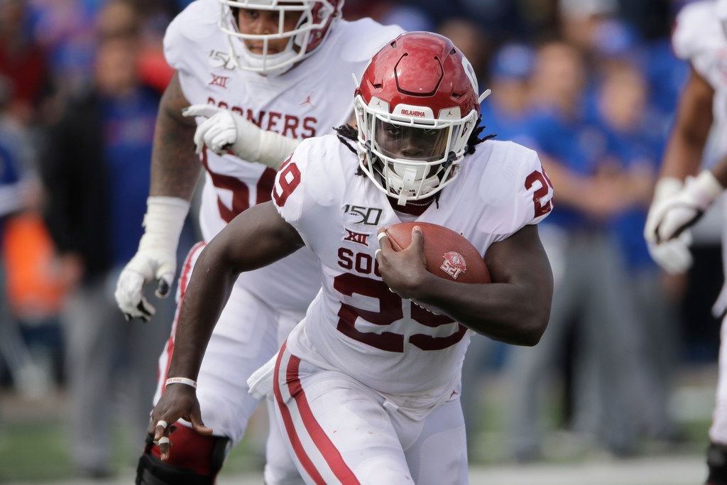 Oklahoma running back Rhamondre Stevenson runs for a touchdown during the second half of an NCAA college football game against Kansas Saturday, Oct. 5, 2019, in Lawrence, Kan. (AP Photo/Charlie Riedel)