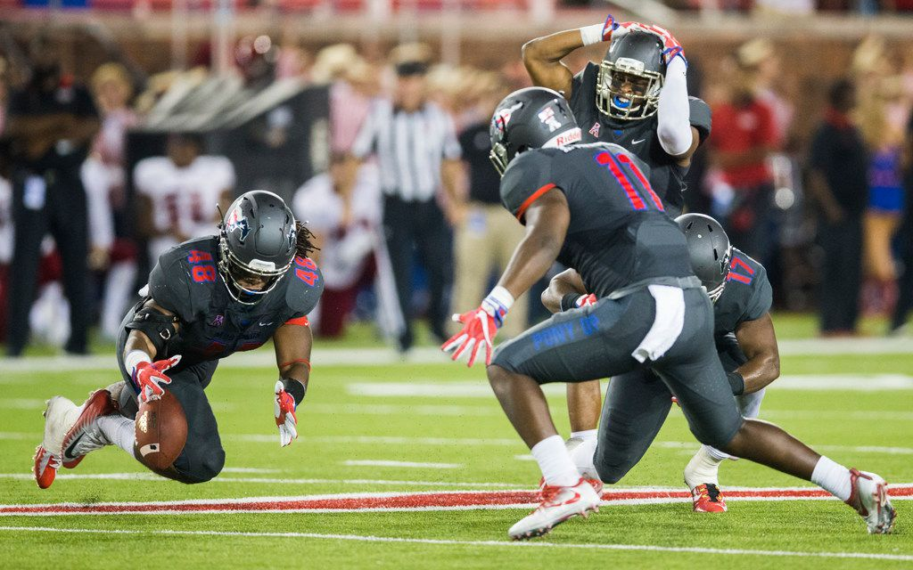 Southern Methodist Mustangs linebacker Anthony Rhone (48) dives to try to recover a narrowly missed interception attempt by linebacker Jordon Williams (17) during the second quarter of a game between Arkansas State and SMU on Saturday, September 23, 2017 at Ford Stadium on the SMU campus in Dallas. (Ashley Landis/The Dallas Morning News)