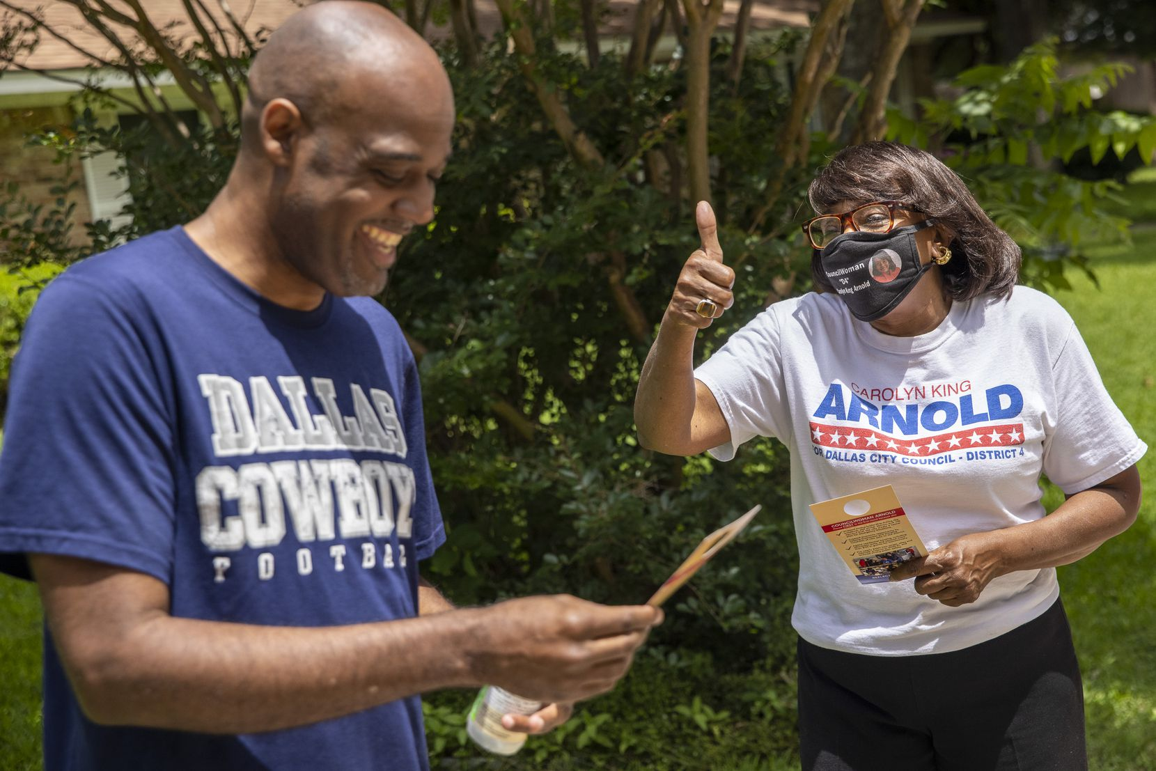 City councilwoman Carolyn King Arnold, right, speaks with Daniel Banks about about the upcoming run-off election while she re-canvasses voter homes in the Glen Oaks neighborhood in south Dallas on Friday, May 21, 2021. Arnold is in a run-off against Dallas ISD school board trustee Maxie Johnson. (Lynda M. González/The Dallas Morning News)
