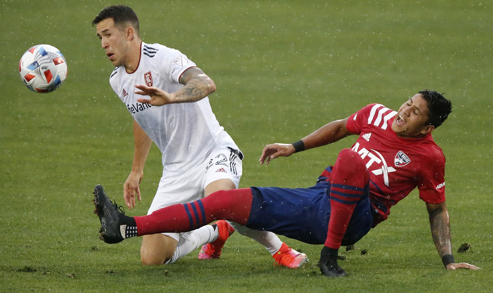 FC Dallas midfielder Freddy Vargas (17) collided with Real Salt Lake defender Aaron Herrera (22) during the first half as FC Dallas hosted Real Salt Lake at Toyota Stadium in Frisco on Saturday, May 22, 2021. (Stewart F. House/Special Contributor)