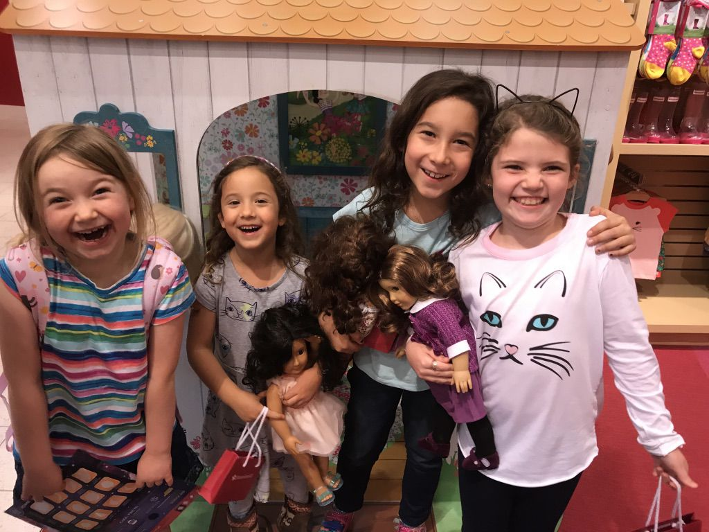 Libby Gonzales, second from right, celebrates her eighth birthday with friends at the American Girl Doll store.