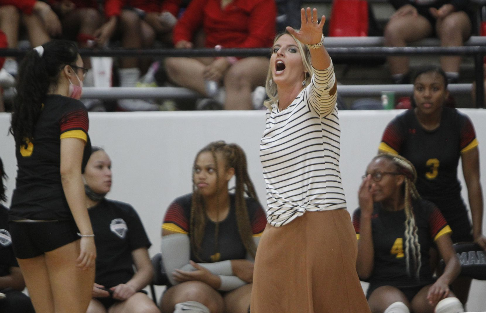 South Grand Prairie head coach Lindsay Fallen reacts to a call during the 3rd set of their match against Arlington Martin. The two teams played their volleyball match at Arlington Martin High School in Arlington on September 14, 2021. (Steve Hamm/ Special Contributor)