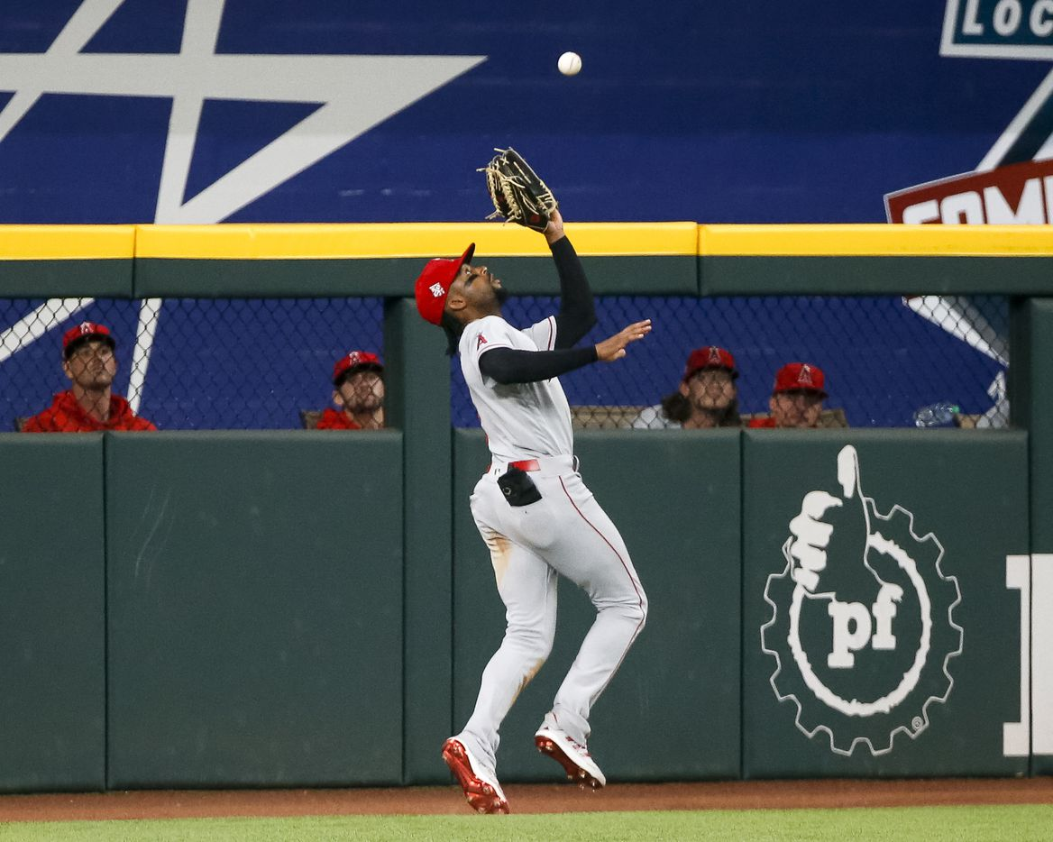 Los Angeles Angels left fielder Jo Adell (7) catches a fly ball at the warning track from Texas Rangers second baseman Andy Ibanez (77) during the ninth inning at Globe Life Field on Thursday, Aug. 5, 2021, in Arlington. (Elias Valverde II/The Dallas Morning News)