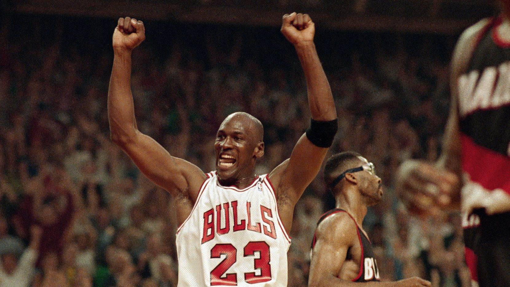 In this June 14, 1992, file photo, Michael Jordan celebrates the Bulls win over the Portland Trail Blazers in the NBA Finals in Chicago. Decades after Jordan's groundbreaking departure from college, March Madness and the NBA's mega-millions have taken all the novelty out of leaving early for the pros.