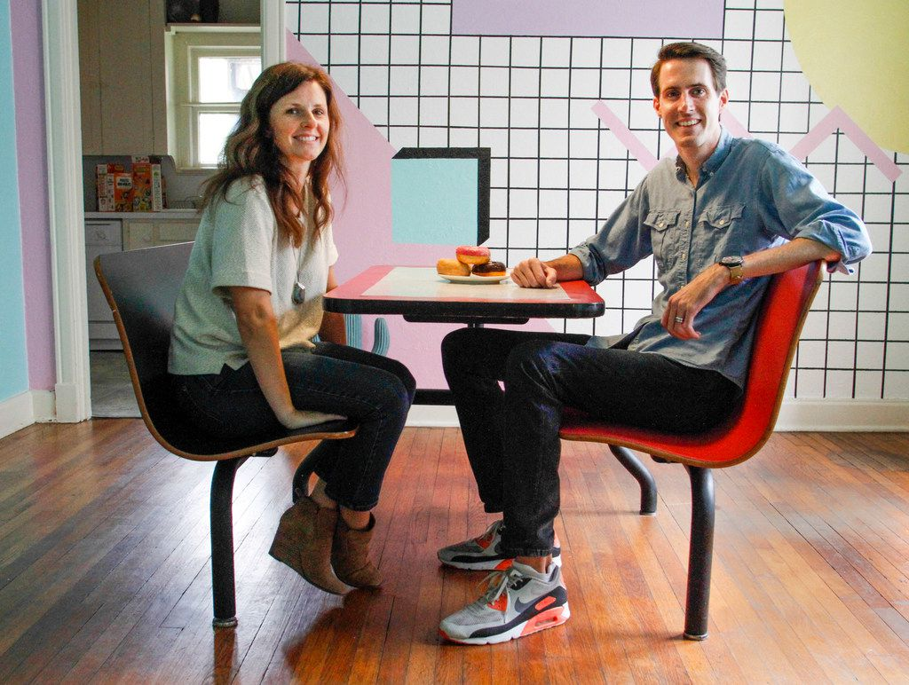 Owners Jeremy and Kelsey Turner sit at the dining table in The McFly.