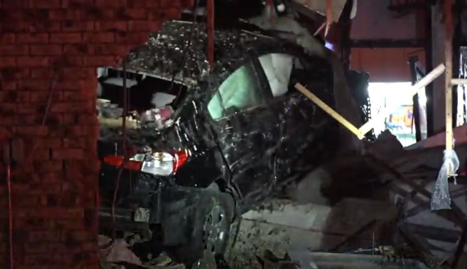 A car crashed into a Fort Worth pizza restaurant Monday night, injuring four people.