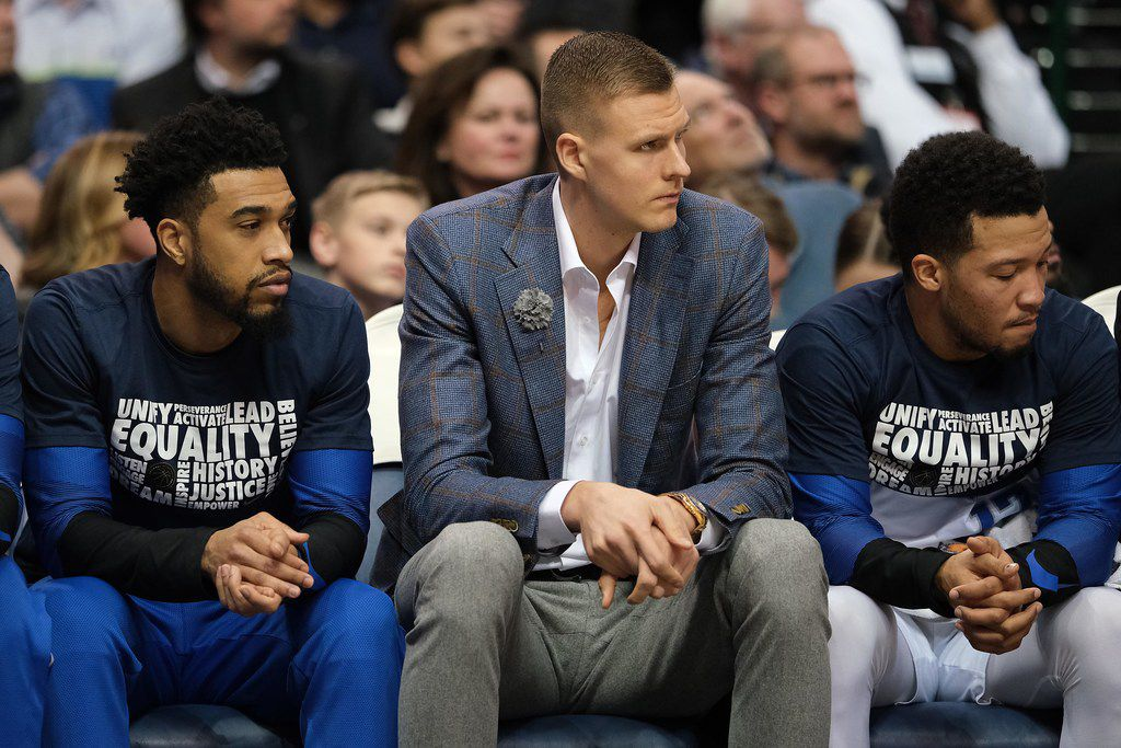 Dallas Mavericks forward Kristaps Porzingis watches from the bench during the first half of an NBA basketball game at American Airlines Center on Friday, Feb. 8, 2019, in Dallas. (Smiley N. Pool/The Dallas Morning News)