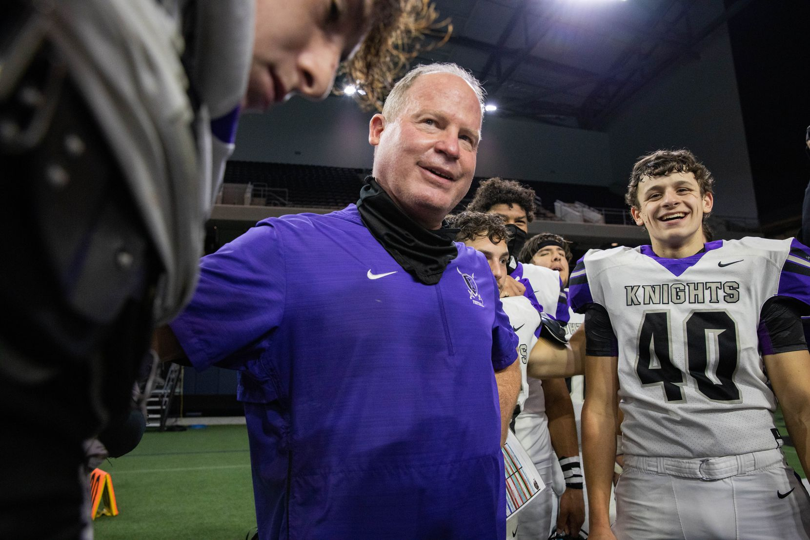 Frisco Independence football coach Kyle Story gathers to pray with his team following their win against Frisco Heritage at the Ford Center at the Star in Frisco on Thursday, Dec. 3, 2020. (Juan Figueroa/ The Dallas Morning News)