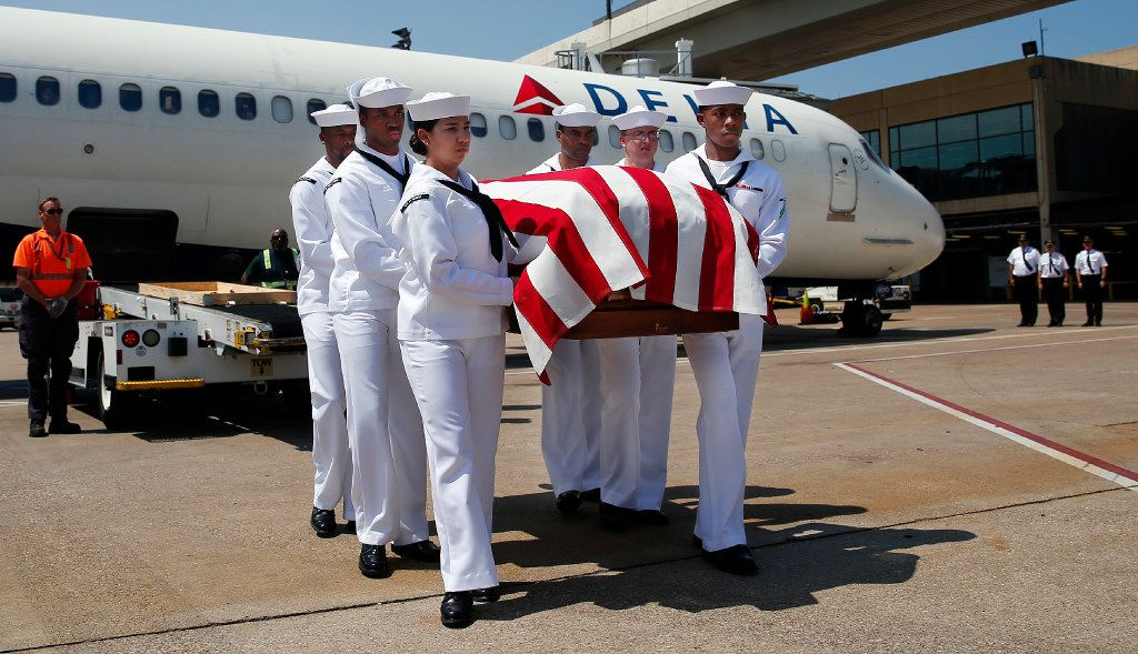 A Navy honor guard carries remains of Seaman 1st Class George A. Coke Jr. of Arlington as they are unloaded from a commercial flight at DFW International Airport on Friday, June 23, 2017. Coke, who perished aboard the USS Oklahoma after it sank at Pearl Harbor, was identified through DNA testing. A service for Coke will be held at First United Methodist Church in Arlington on Saturday before he is buried at Parkdale Cemetery.