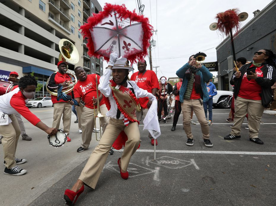 """""""¡Soltar!"""" grandmaster and choreographer Michelle Gibson backed by the Big Easy Brass Band."""