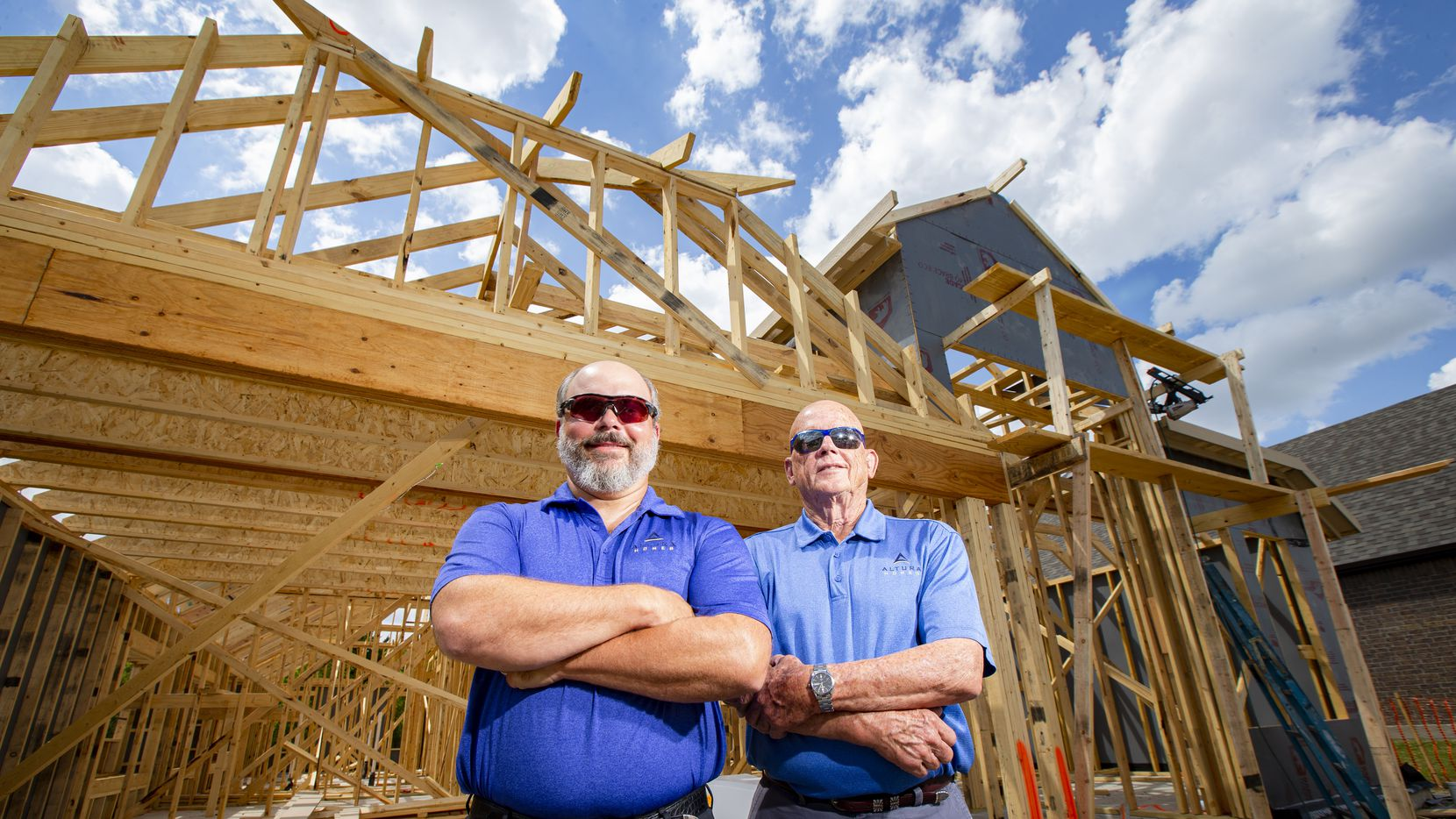 Justin Webb (left), owner of Altura Homes, and Donnie Evans, president of the company, said they haven't furloughed any workers despite the pandemic. They're shown at a home under construction in the Sonoma Verde development in Rockwall.