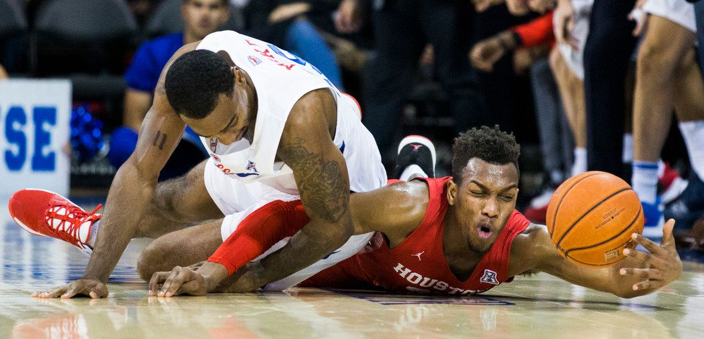Southern Methodist forward Isiaha Mike (15) and Houston Cougars forward Fabian White Jr. (35) reach for a loose ball during the first half of a basketball game between SMU and University of Houston on Saturday, February 15, 2020 at Moody Coliseum in Dallas. (Ashley Landis/The Dallas Morning News)