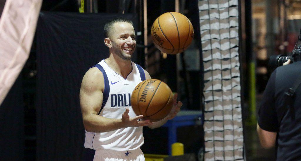 Dallas Mavericks guard J.J. Barea juggles for a photo during an NBA basketball team media day in Dallas, Monday, Sept. 25, 2017. (AP Photo/LM Otero)