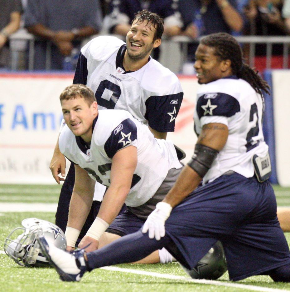 ORG XMIT: *S0427318953* 08/1709  142414 Tony Romo, Jason Witten and Marion Barber laugh while stretching at practice at the Dallas Cowboys Training Camp at the Alamodome in San Antonio on Monday,  August 17, 2009.  (Michael Ainsworth / The Dallas Morning News)