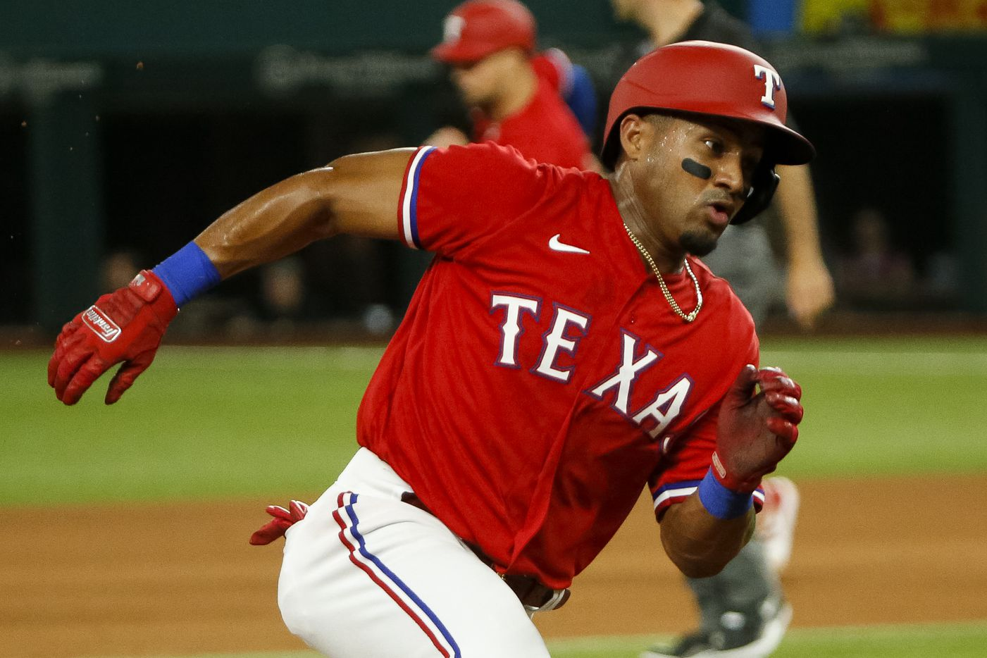 Texas Rangers designated hitter Andy Ibanez (77) runs to third base during the sixth inning against the Kansas City Royals at Globe Life Field on Friday, June 25, 2021, in Arlington. (Elias Valverde II/The Dallas Morning News)