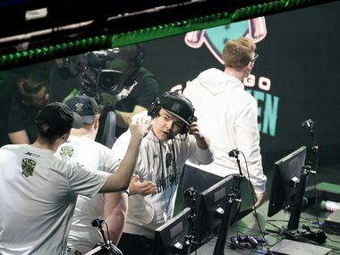 FormaL (Matthew  Piper) celebrates with Chicago Huntsmen teammates after their victory against Dallas Empire in the first match of in the Call of Duty League Launch Weekend at the Armory in Minneapolis, Minn., January 24, 2020.