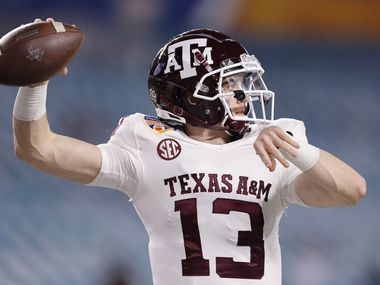 MIAMI GARDENS, FLORIDA - JANUARY 02: Haynes King #13 of the Texas A&M Aggies warms up prior to the Capital One Orange Bowl against the North Carolina Tar Heels at Hard Rock Stadium on January 02, 2021 in Miami Gardens, Florida.