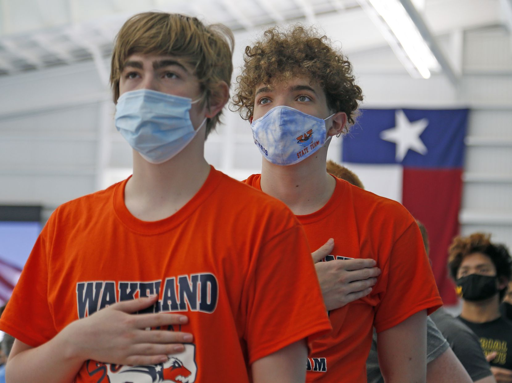 Wakeland swimmers stand for the opening ceremony. UIL boys 5A swim finals on Saturday, Feb.27,2021 at Bill Walker Pool and Josh Davis Natatorium