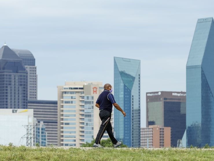 A man walks along the Trinity Levee Trail on Wednesday, Aug. 18, 2021, in Dallas. (Elias Valverde II/The Dallas Morning News)