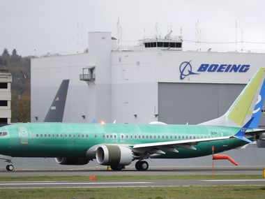 A Boeing 737 MAX 8 airplane rolls toward takeoff before a test flight at Boeing Field in Seattle.