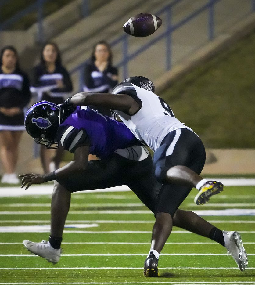 Mansfield Timberview's Zach Essih (9) hits Waco University quarterback Damarion Chambers (7) as he tries to pass in a high school football game at Waco ISD Stadium on Friday, Oct. 8, 2021, in Waco, Texas.