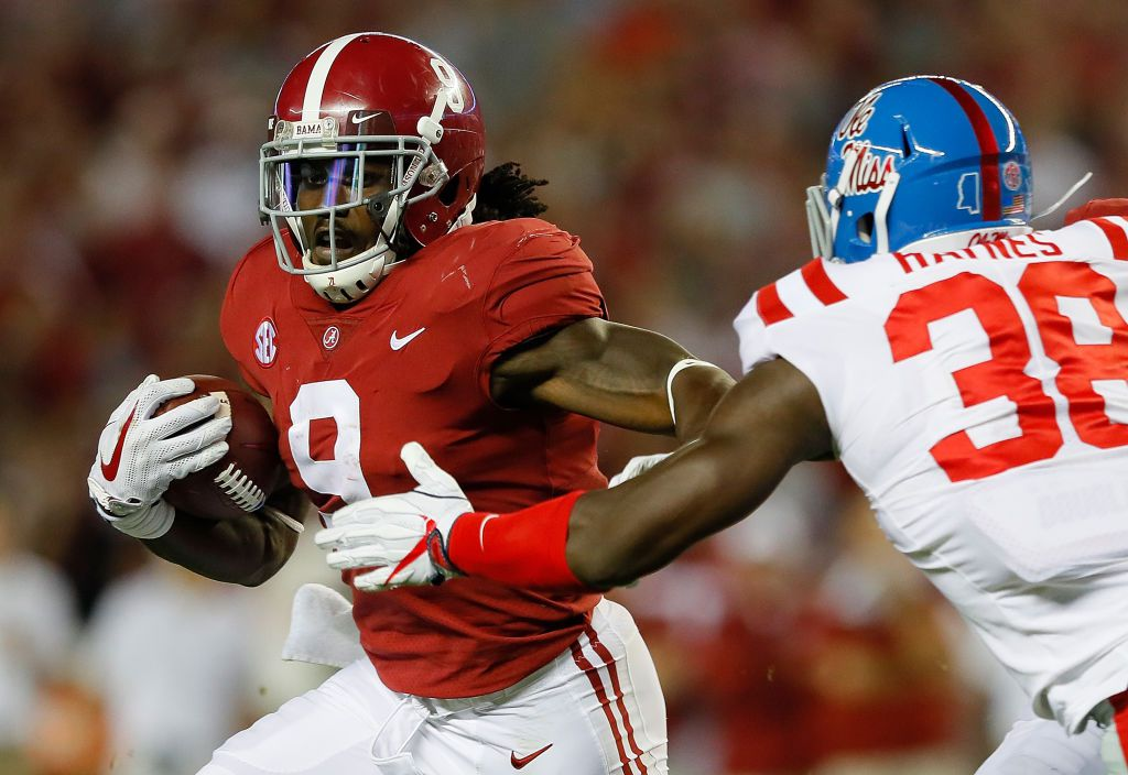 TUSCALOOSA, AL - SEPTEMBER 30:  Bo Scarbrough #9 of the Alabama Crimson Tide rushes away from Marquis Haynes #38 of the Mississippi Rebels at Bryant-Denny Stadium on September 30, 2017 in Tuscaloosa, Alabama.  (Photo by Kevin C. Cox/Getty Images)