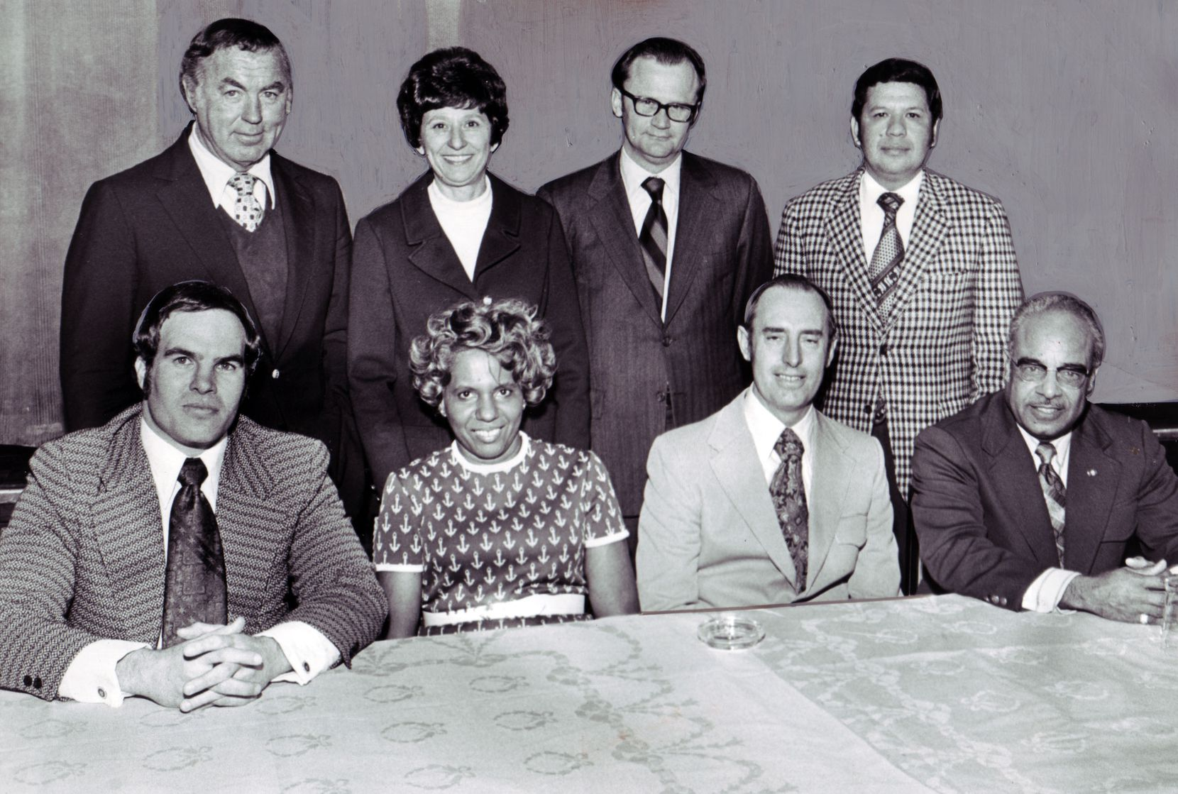 Citizens Charter Association candidates for City Council: (seated) Charles Terrell, Lucy Patterson, L. A. Murr, and George Allen; and (standing) Fred Zeder, Adlene Harrison, Russell Smith and Pedro Aguirre as seen in a February 25, 1973 Dallas Morning News article. Dallas News Staff Photo by Jack Beers.