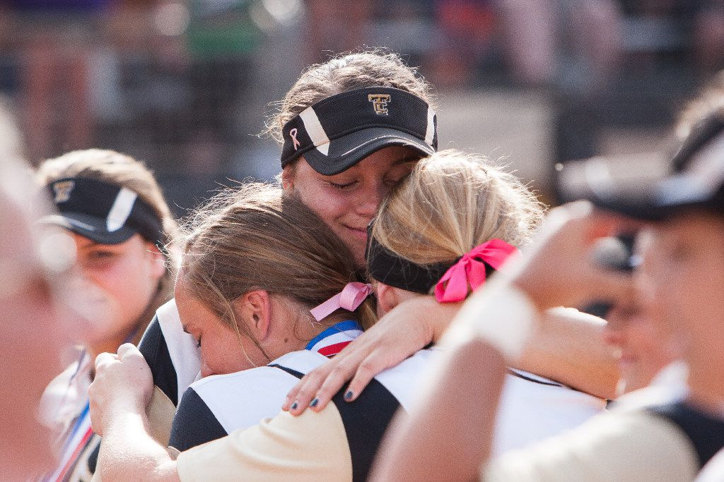 The Colony's Jayda Coleman, center, embraces teammates after the medal ceremony during the UIL 5A state softball championship at McCombs Field in Austin, Texas on Saturday June 3, 2017. The Colony Cougars defeated the Willis Wildkats 5-2. (Julia Robinson/Special Contributor)